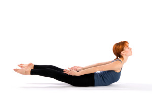 Slim Young Woman doing Yoga Exercise